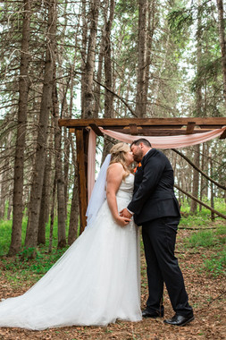 first kiss, bride and groom, wedding dress