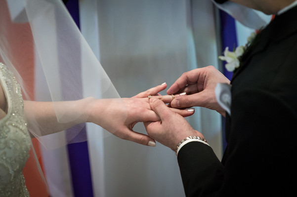 Highwood Lutheran Church Wedding, Bride and Groom place rings