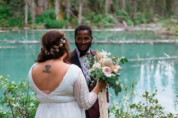 Bride and groom having their first look with Emerald Lake in the background.