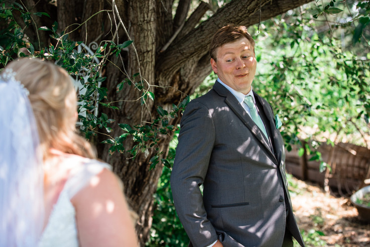 Groom turning around to see his bride for the first time during the first look.
