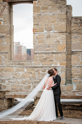 Outdoor Calgary elopement, bride and groom photos, first kiss