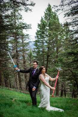 Bride and groom holding sword props