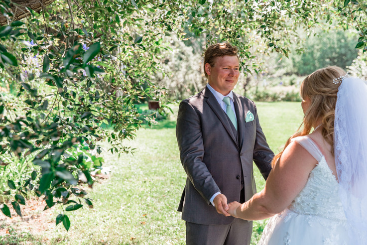 Emotional moment of the groom seeing his bride during the first look.