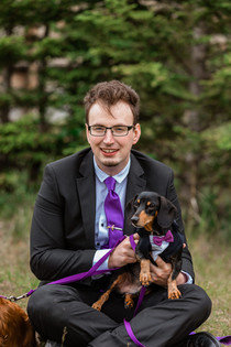 Groom with his wiener dog both wearing purple accents at Cascade ponds.