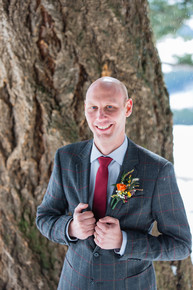Boutonniere, groom, floral shot
