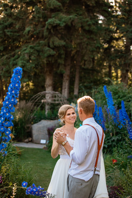 bride and groom dancing surrounded by big beautiful flowers.