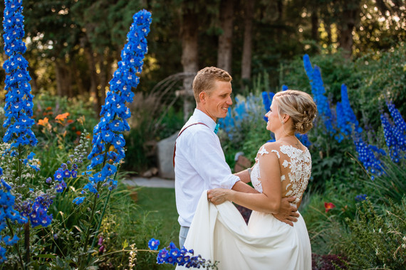 bride and groom dancing among the tall flowers