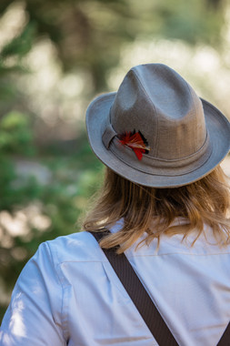 Grooms fedora with a little feather tucked in.