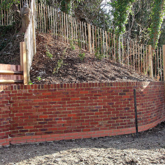 Foxholes Avenue Curved retaining brick wall