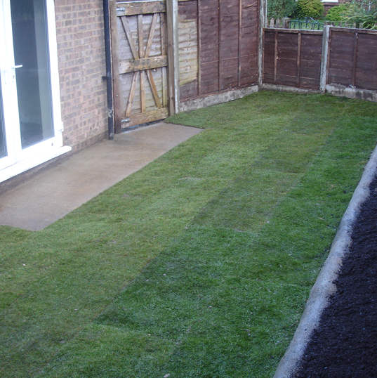 Hand moulded concrete walls and new turf