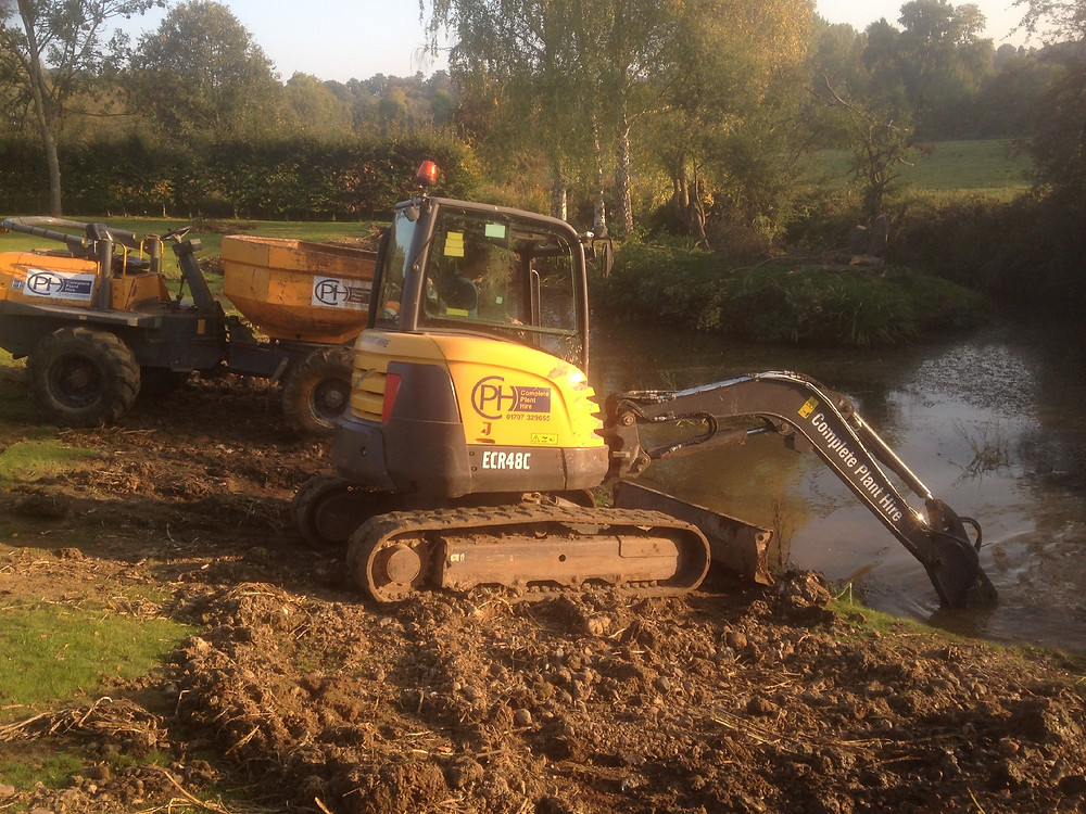 specialist landscape consultants using heavy plant to reshape the flood plain to take enough volume of flood water