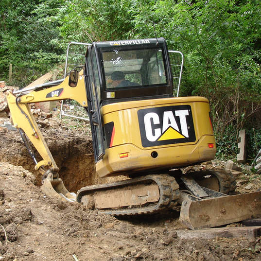 Hard landscaping and earth moving with a Caterpilla