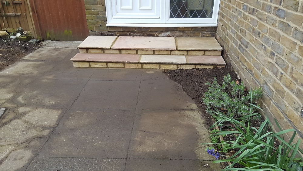 Stone front steps giving a sturdy yet homely welcome