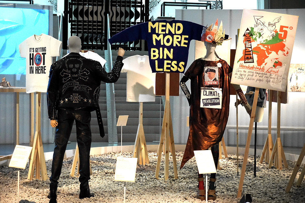 Katherine Hamnett 'Clean up or die' jacket 1989, Bridget Harvey 'Mend more' jumper 2015, Vivian Westwood dress 2012