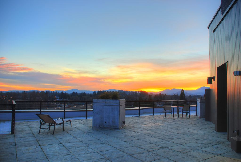22 Rooftop sunset over coastal range - w
