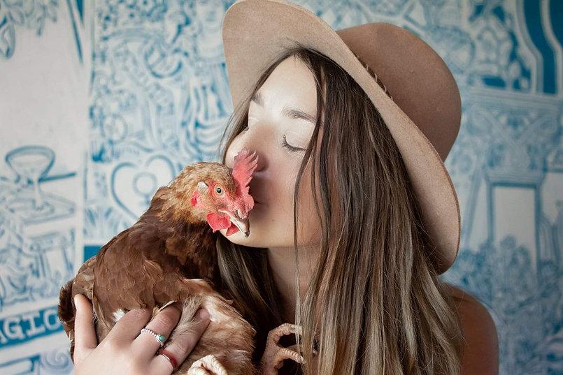 kissing a chook.jpg