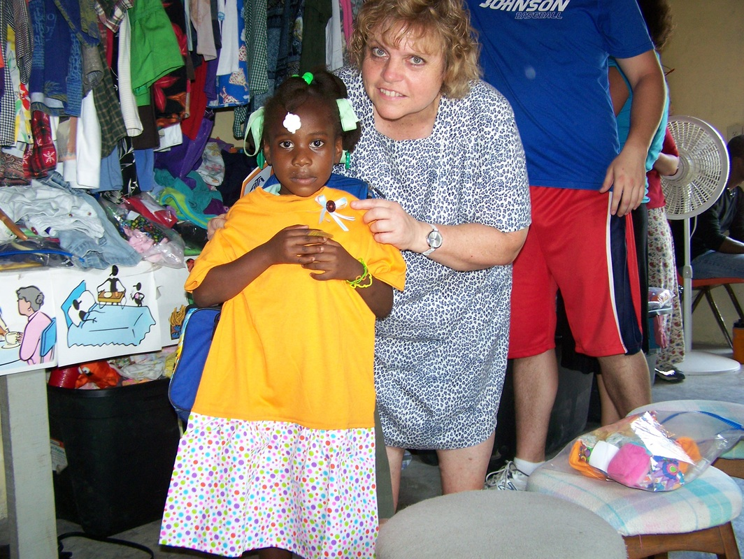 Child recieves a dress