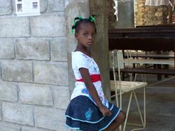 Child wearing Ladybug dress