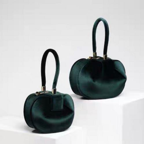 Audrey Marc retro look dumpling round handcarry bag with handle