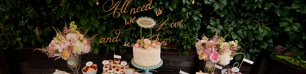 Wedding Desserts with boxwood backdrop