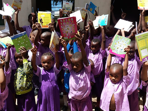 Distribution of donated books to the children