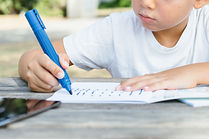 close-up-of-kid-writing-in-notepad-PCUGY