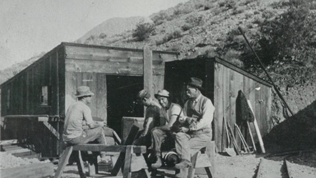 Miners taking a break from work just outside of an entrance into the Tropico Gold Mine (c. 1912)