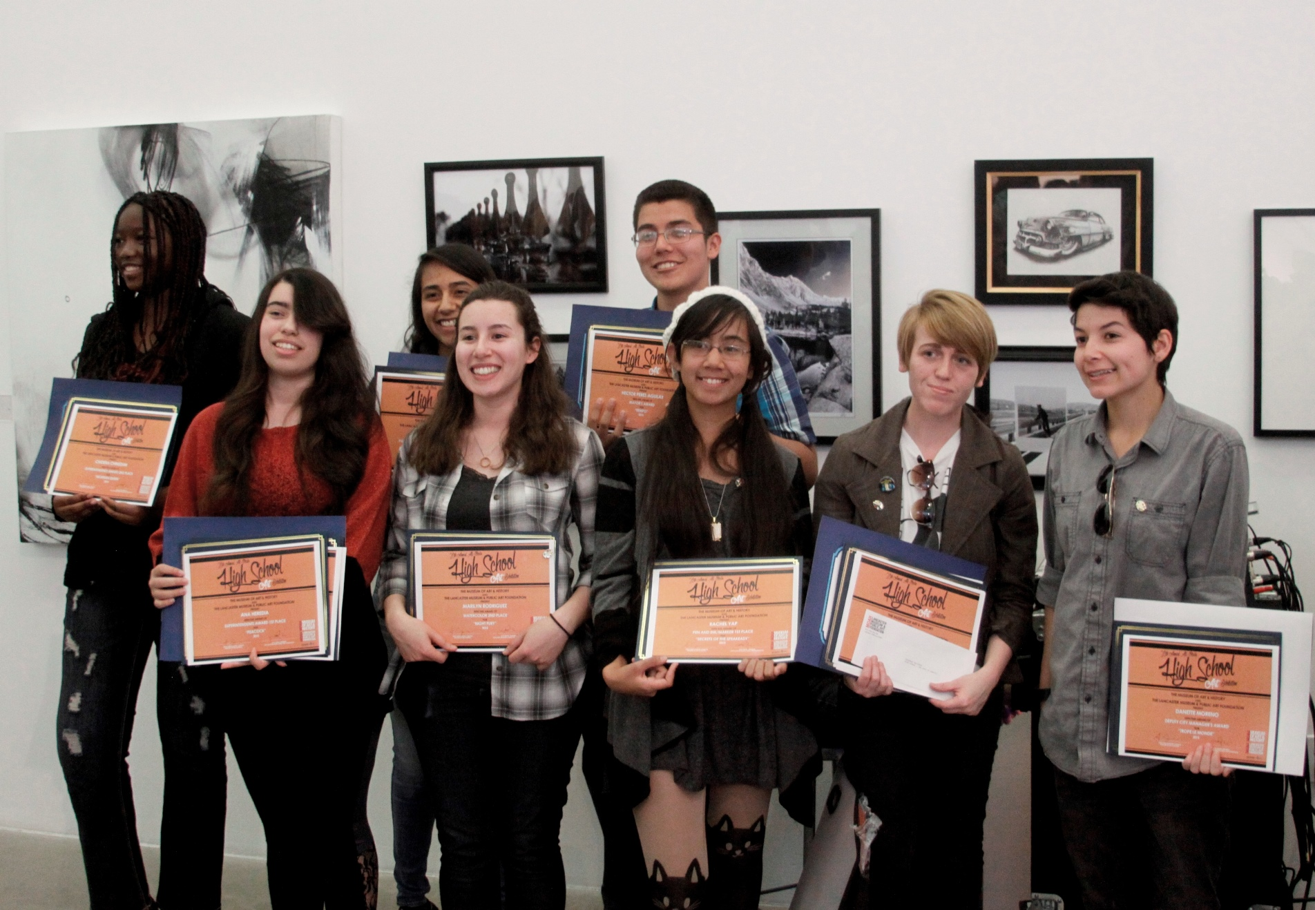 Several young artists pose for a group photo