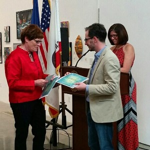 Marthe Aponte Receiving Award from LMPAF President Josh Mann