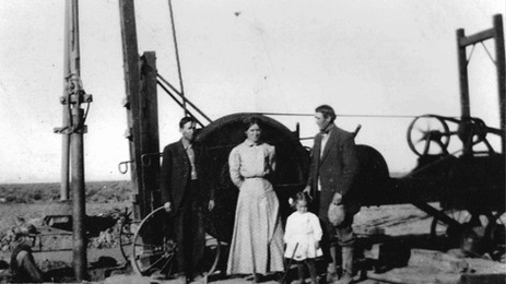 Corum Family Members Standing Near a Well c. 1911