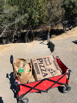 Meals &  bags ready to be handed out; Pizza is not ideal but it works in a pinch!