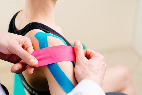Kinesiotaping. Physical therapist applyi