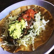 Gluten free vegan taco with vegan cheese