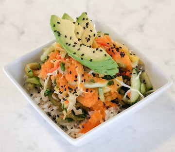 Coconut rice with bok choy, mango slaw, carrot ginger dressing
