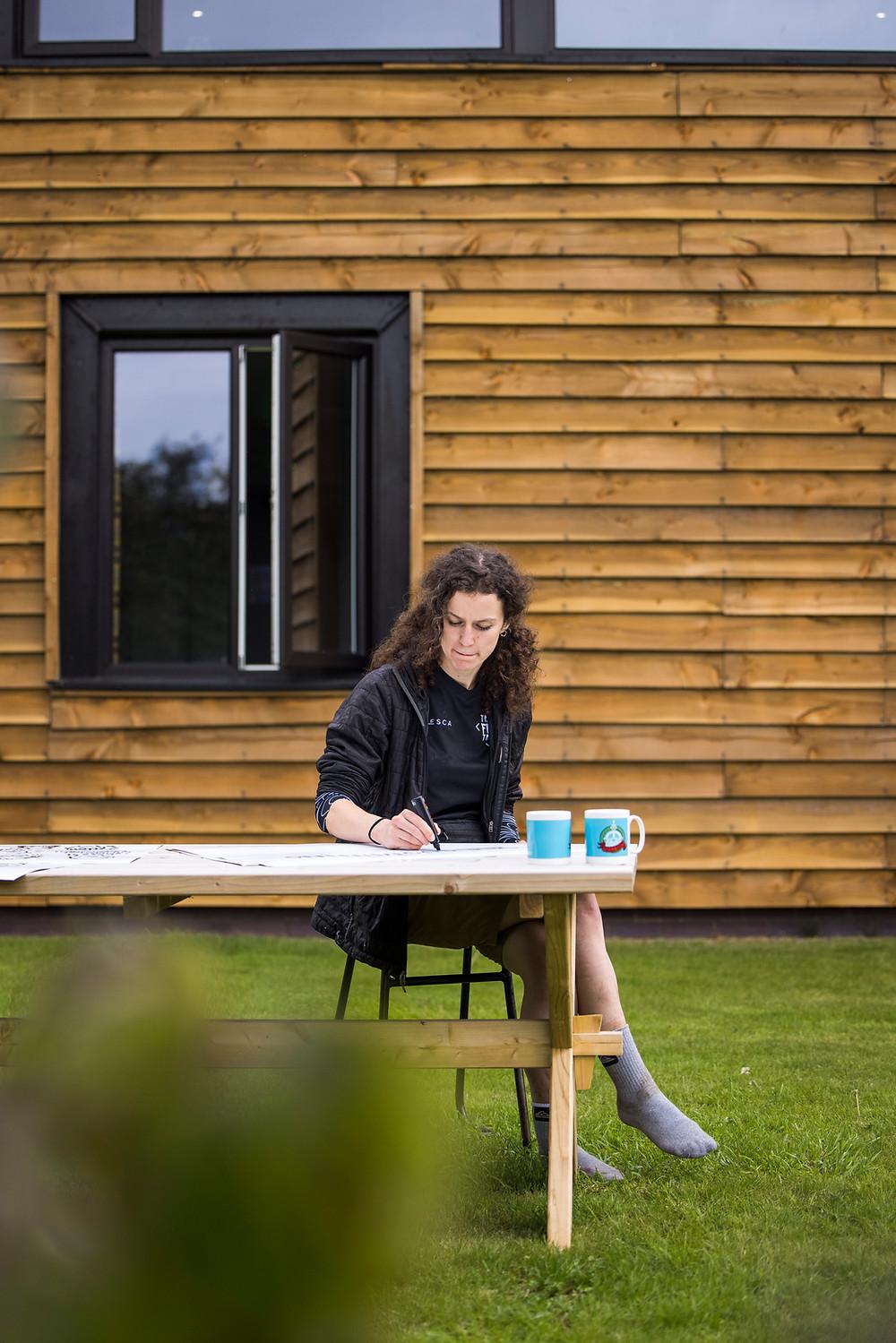 TFT Designer Beth taking notes - (C) Sam Dugon