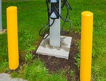 EV charger on green grass lawn. EV - ele
