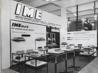 """IME 84 electronic calculators exhibited at the 2nd SMAU at the Milan Fair - 9/24/1965  """"The SMAU (Salone Machinery and Equipment for the Office) is the leading trade fair Italian dedicated to information and communication technologies. It was first held in 1964."""" Source: Wikipedia  In 1964 """"SMAU, the Office Machinery and Equipment Exhibition is born: the first edition showcased 250 exhibitors and was visited by 9,432 people."""""""