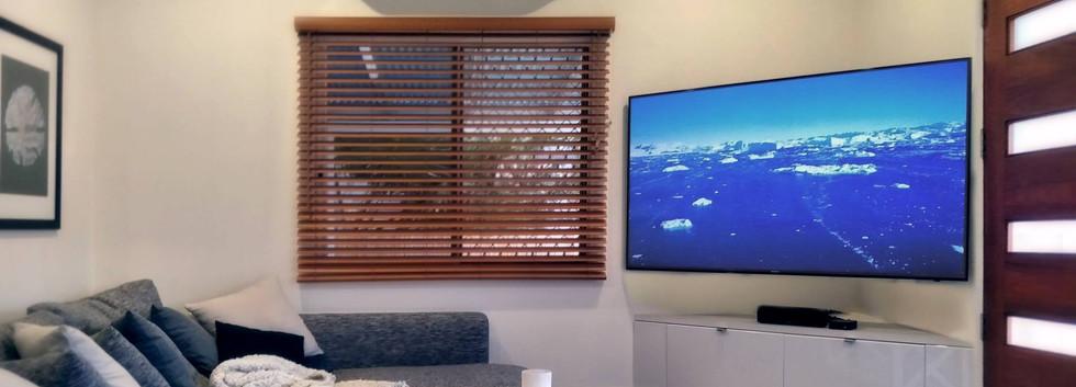 Large Corner Mounted 4k TV