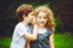 Little boy and girl whispers..jpg