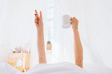 blonde-girl-having-coffee-in-the-morning