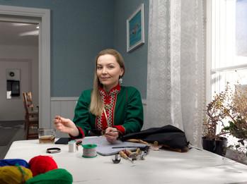 Julia sewing Sámi bracelets