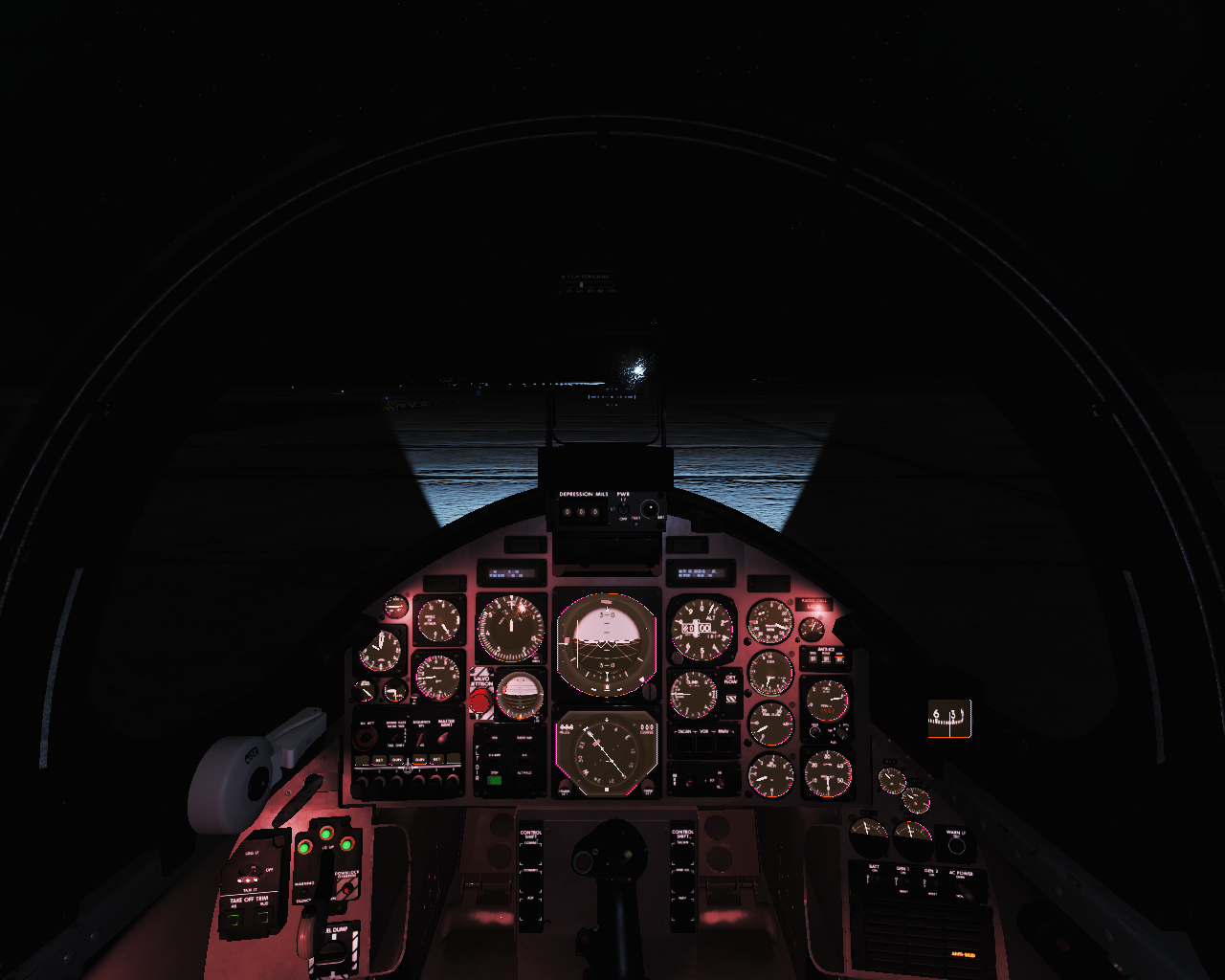 Nightime cockpit with gauge and flood lights on.