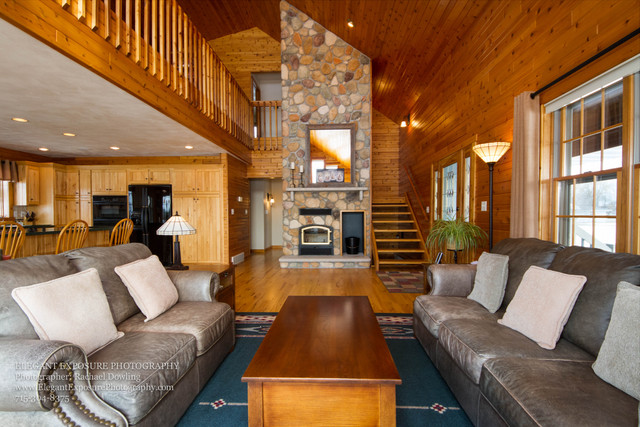 log cabin, gray couch, open concept, fireplace