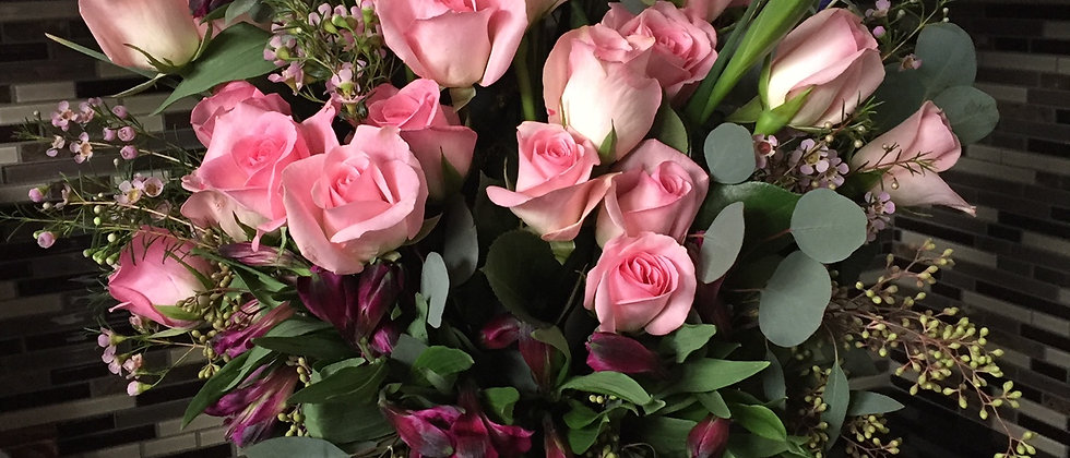 Rose Garden: 2 doz Roses with cool greens & spring flowers in vase