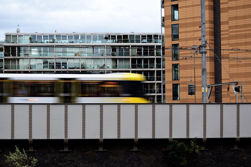 Fast Moving Yellow Manchester Metrolink Tram
