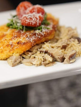 Chicken Milanese over mushroom pasta risotto