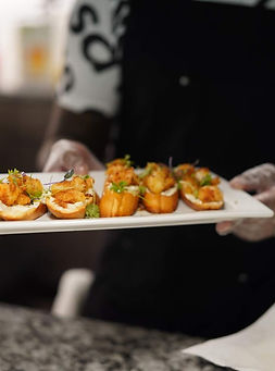 Fried shrimp crostini with herb cream cheese spread