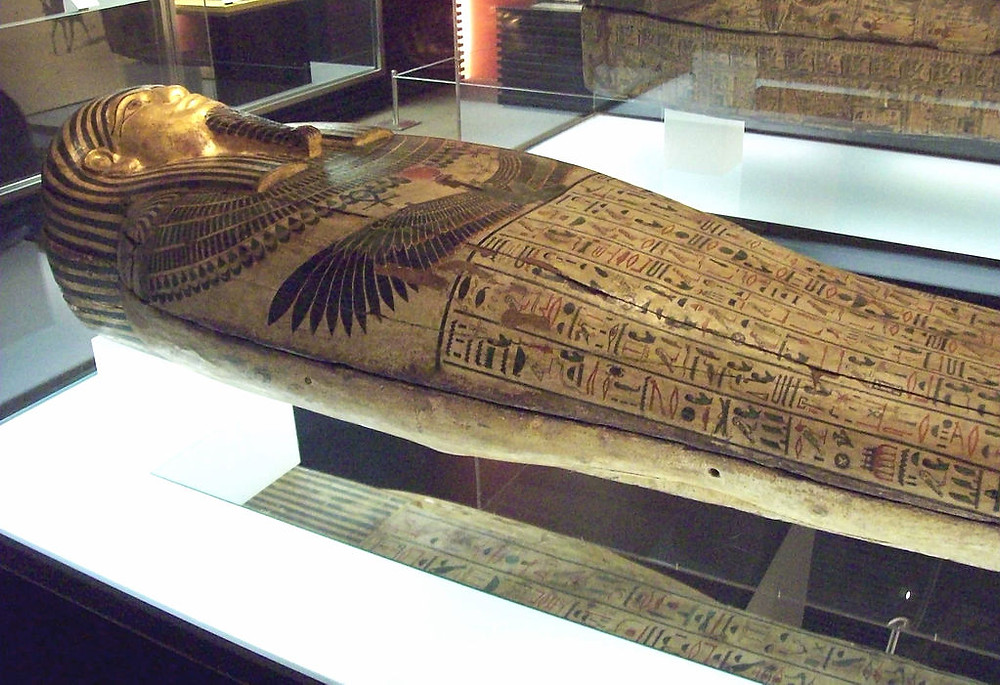 wooden coffin from saqqara necropolis. the wooden coffin is decorated with colorful scenes and hieroglyphics.