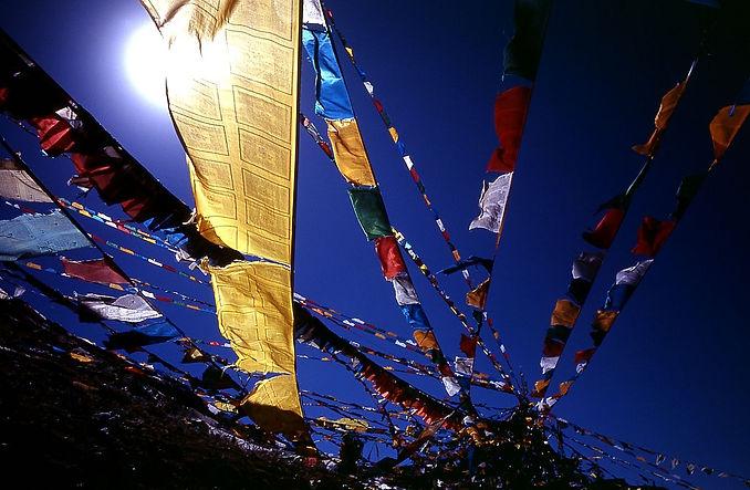 1200px-Blue_sky_prayer_flags_TIBET.jpg