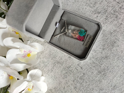 Stirling Silver Necklace. Dried flowers set in resin pendant